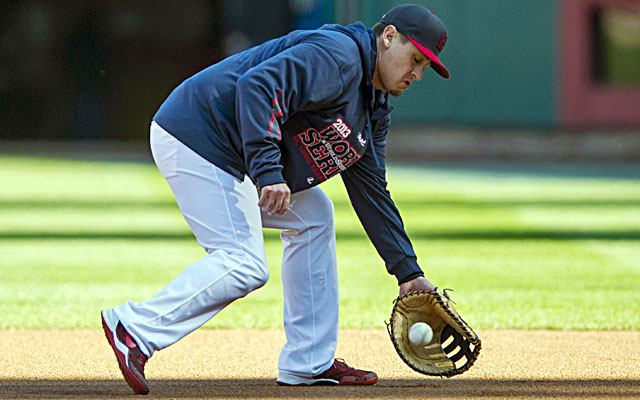 Allen Craig, taking ground balls at first base, is likely only available to pinch hit in Game 3. (USATSI)