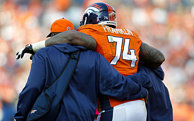 Broncos tackle Orlando Franklin is helped off the field after getting injured against the Jaguars. (USATSI)
