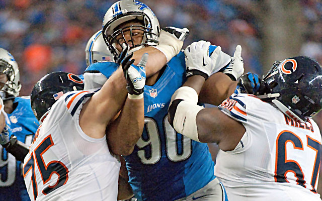 Kyle Long (left) will have his hands full with Ndamukong Suh (center) once again. (USATSI)