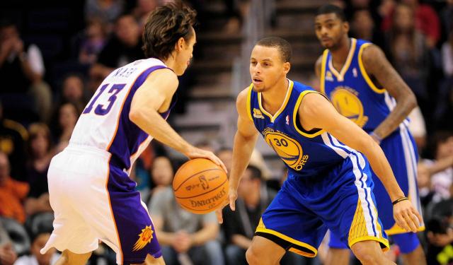 Steve Nash admires Stephen Curry.  (USATSI)