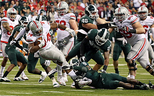 Michigan State defenders take down Ohio State running back Carlos Hyde. (USATSI)