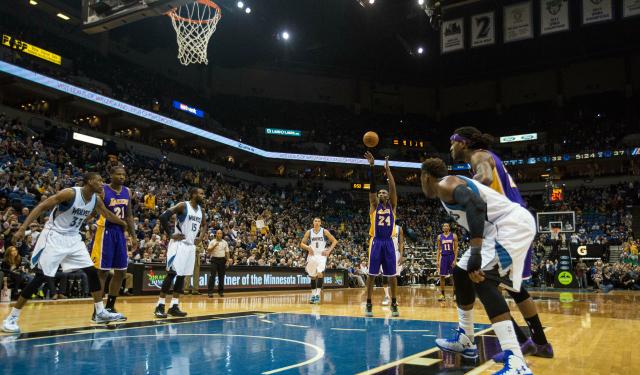 Kobe Bryant surpasses Michael Jordan's all-time scoring total.  (USATSI)