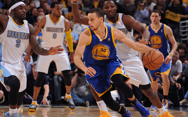 The Nuggets swarmed Curry on Tuesday.    (Getty Images)
