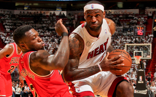 LeBron James bowled over Nate Robinson and the Bulls. (Getty Images)