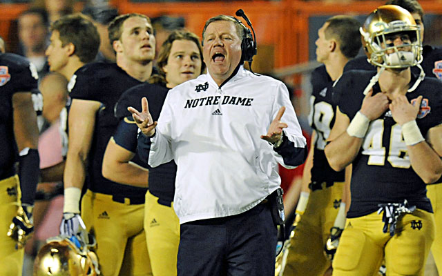 Brian Kelly's presence will be crucial through this transition to whoever takes snaps in 2013. (USATSI)