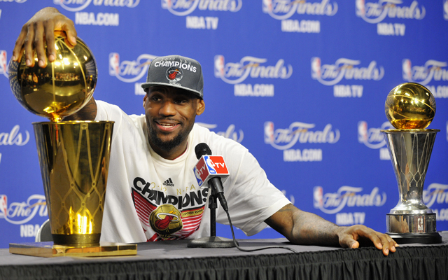 LeBron James wins his first NBA title as the Heat close ...
