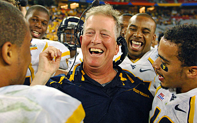 Bill Stewart (center), who died in 2012, guided WVU to a 48-28 win over Oklahoma in the 2008 Fiesta Bowl. (USATSI)