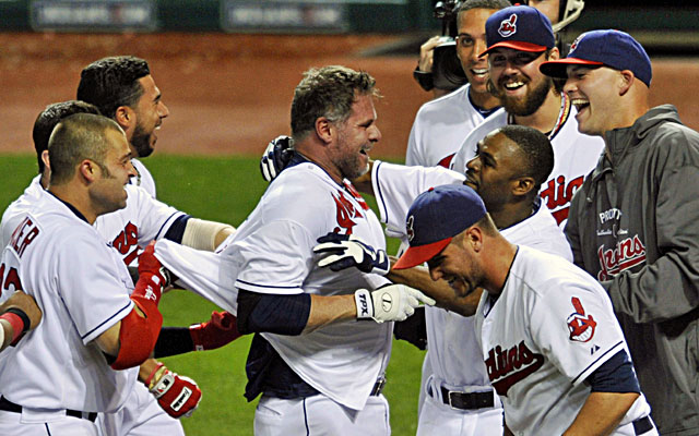 Jason Giambi (center) is mobbed by teammates after hitting a pinch-hit home run against the White Sox. (USATSI)