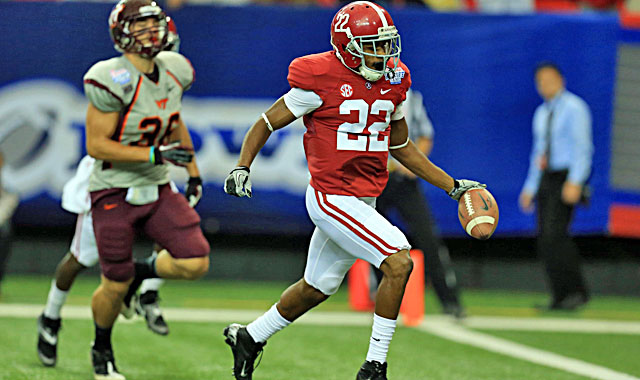Christion Jones scores on a punt return (above), returns a kickoff for a TD and makes Alabama history. (USATSI)