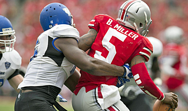 Khalil Mack terrorizes Ohio State, compiling 9 1/2 tackles, 2 1/2 sacks, an interception (returned for a TD). (USATSI)