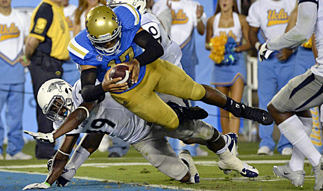 UCLA quarterback Brett Hundley dives into the end zone in a romp over Nevada. (USATSI)