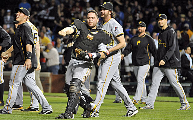 Catcher Russell Martin  and the Pirates celebrate after beating the Cubs at Wrigley. (USATSI)