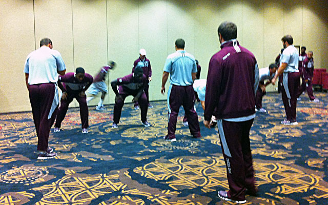Texas A&M players go through formations and play calls in one of the hotel ballrooms. (CBSSports.com)