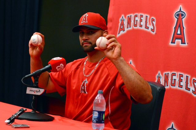 Pictured above: Two of many baseballs that Albert Pujols has and will hit out of the park. (USATSI)