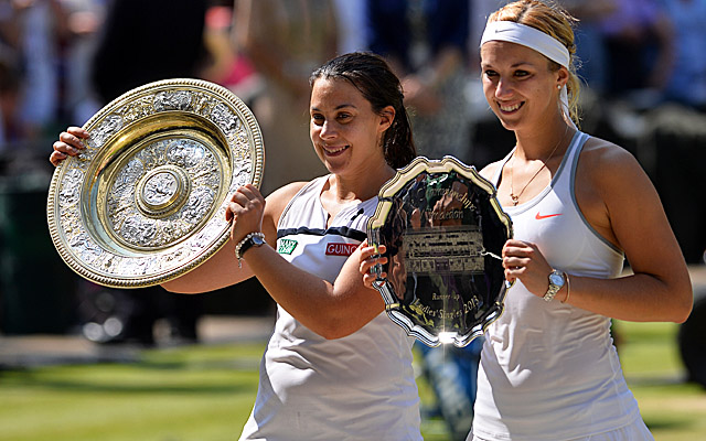 Marion Bartoli (left) shows off the Venus Rosewater Dish after winning her first Grand Slam title. (Getty Images)