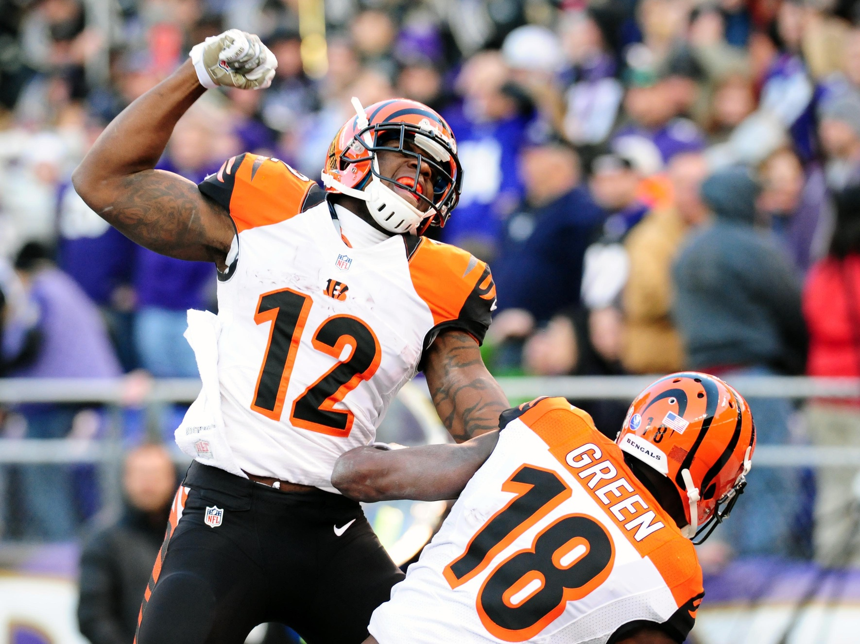 The Bengals celebrate following an improbable Hail Mary touchdown.