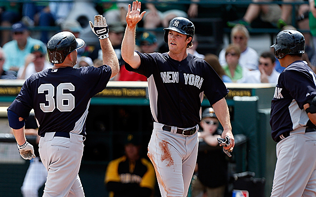 Brennan Boesch (center), who made his Yankees debut last week, has a 'stiff ribcage.' (Getty Images)