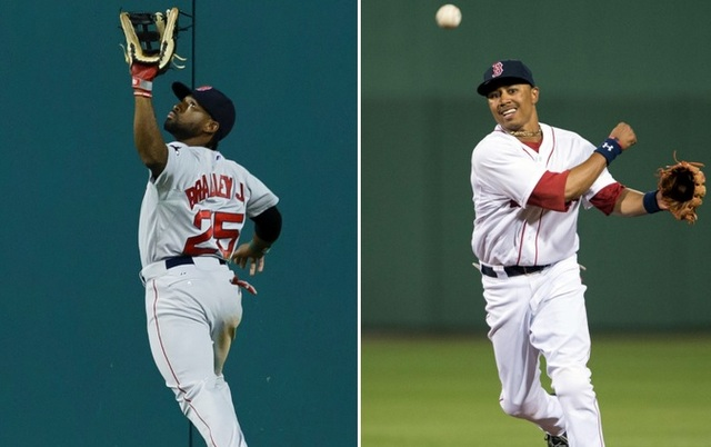 Jackie Bradley Jr. (l.) and Mookie Betts face uncertain futures with the Red Sox.