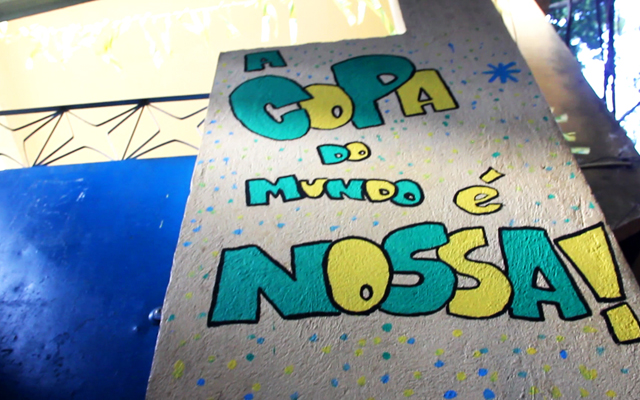 A school in Rocinha with 'The World Cup Is Ours' painted near its entrance.