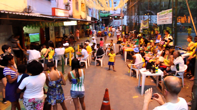 A crowd gathers to watch the second half of Brazil vs. Mexico.