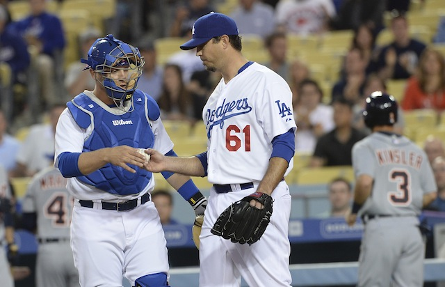 To hear MLB tell it, Dodgers pitchers like Josh Beckett need to pick up the pace. (USATSI)