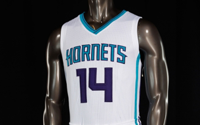The Hornets' new uniforms don't have the logo on the front.  (USATSI)