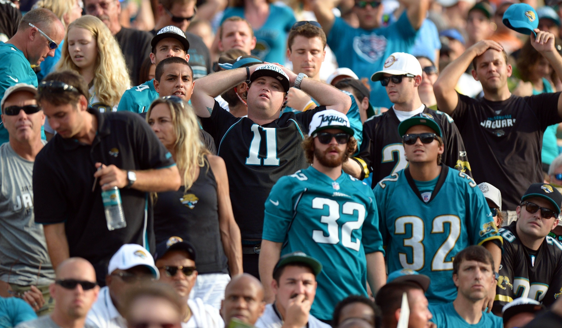These Jaguars fans could use a beer.