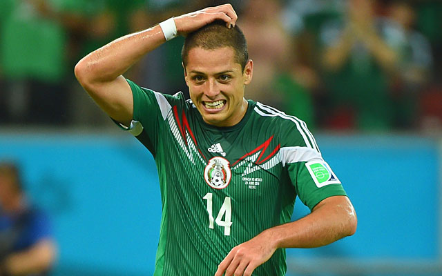 Javier Hernandez is all smiles after scoring Mexico's third goal against Croatia. (Getty)
