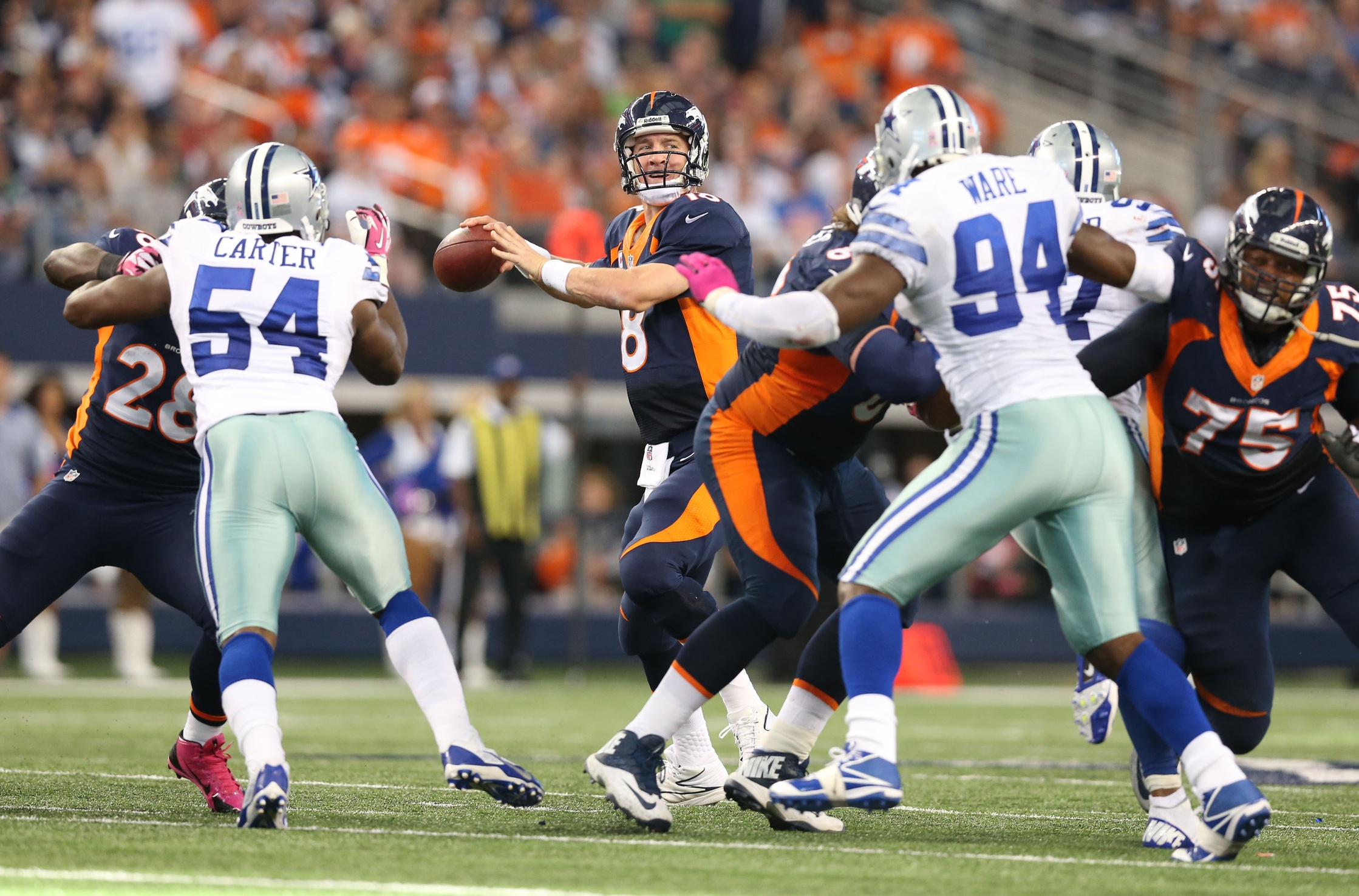 Tony Romo had the historic performance, but Peyton Manning came out on top.