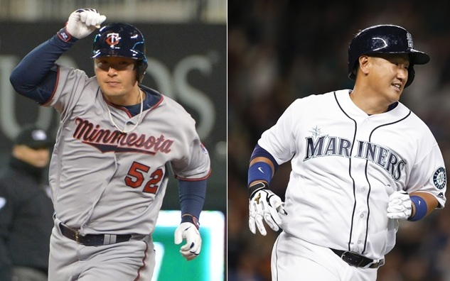 Byung Ho Park (l.) and Dae Ho Lee hit their first MLB home runs Friday night.