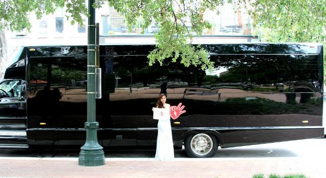 Stephanie Flores stands in front of the party bus Chandler Parsons supplied.