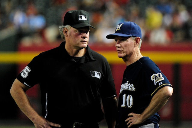 Brewers manager Ron Roenicke (right) isn't a fan of a certain old-school baseball tradition. (USATSI)