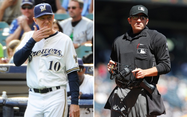 Ron Roenicke (l.) is not happy with ump Mark Ripperger.