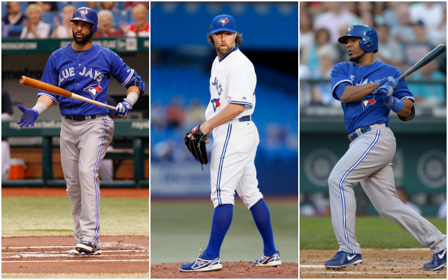 What will 2014 have in store for Jose Bautista (left), R.A. Dickey (center), Edwin Encarnacion and the rest of the Blue Jays? (USATSI)