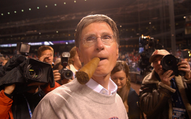 John Henry, seen here celebrating the 2007 World Series, has agreed to buy the Boston Globe.