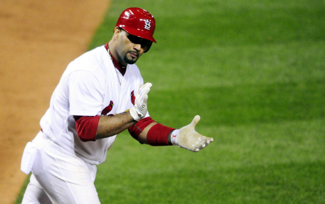 Albert Pujols and Jack Clark have worked out their problems.