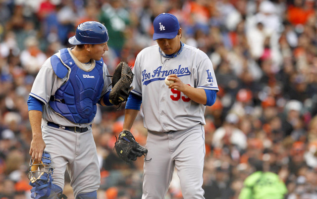 Both A.J. Ellis (left) and Hyun-Jin Ryu are banged up. (USATSI)