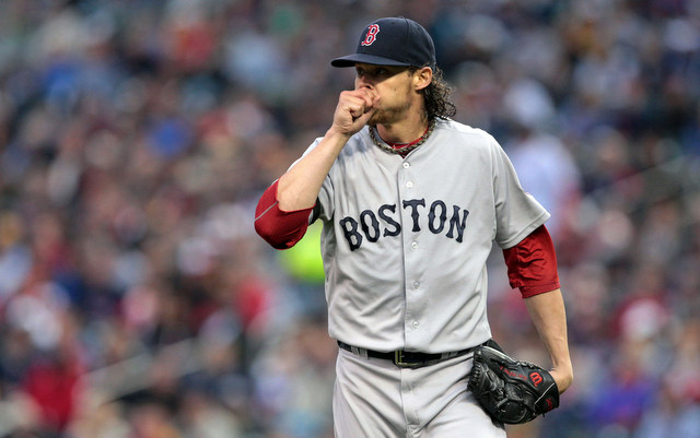 Clay Buchholz will miss a start after sleeping on his shoulder awkwardly. (USATSI)