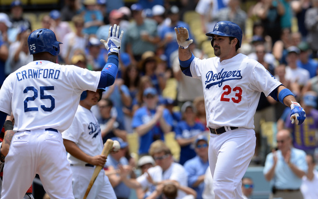Carl Crawford and Adrian Gonzalez changed teams and changed history on this date in 2011