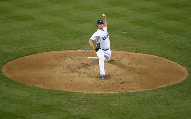 The NL Cy Young line forms behind Clayton Kershaw.