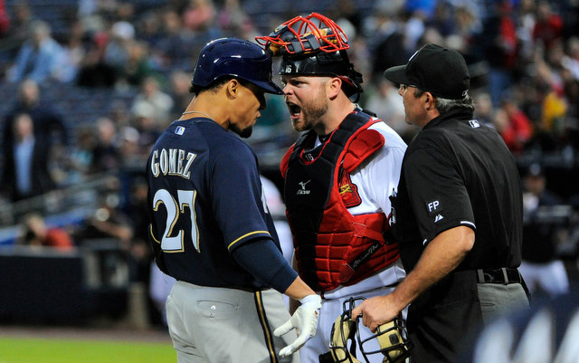 Carlos Gomez (left) was suspended, Brian McCann was not.
