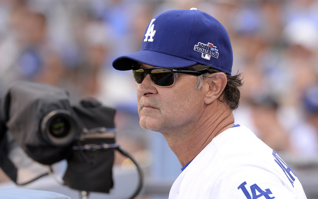 Don Mattingly will be back behind the bench with the Dodgers in 2014.