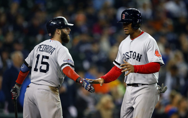 Xander Bogaerts (right)will make his first start of the postseason in Game 5.