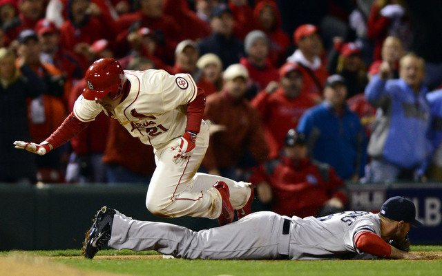 Cardinals base-runner Allen Craig was ruled safe at home after tripping over Will Middlebrooks.