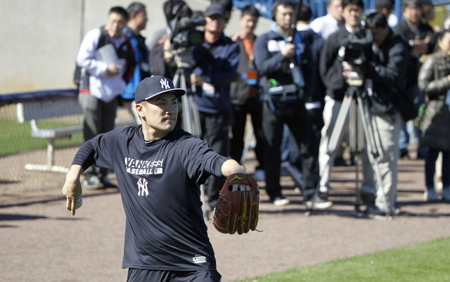 New Yankee Masahiro Tanaka works out with throngs of Japanese media watching.
