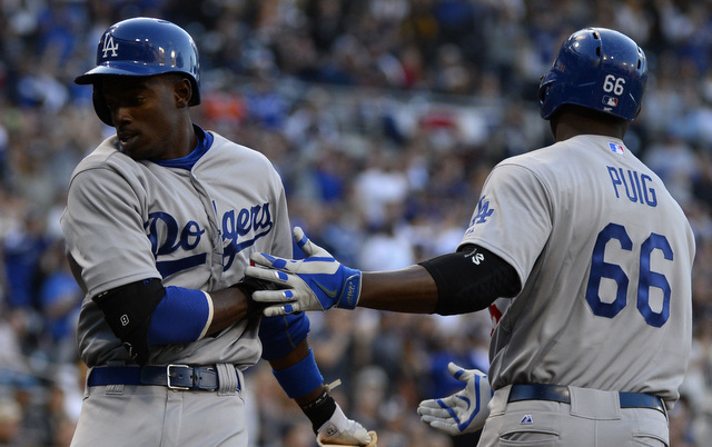 The Dodgers lost both Dee Gordon (l.) and Yasiel Puig to hip problems on Saturday.
