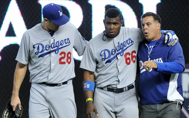 Yasiel Puig crashed into an outfield wall on Sunday.