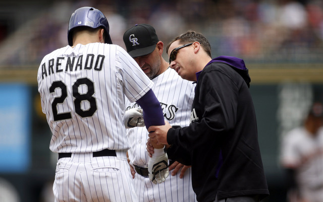 The Rockies suffered a big loss on Friday as Arenado broke a finger on a slide.