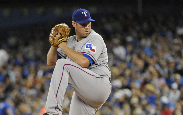 Colby Lewis was not happy with Colby Rasmus on Saturday.
