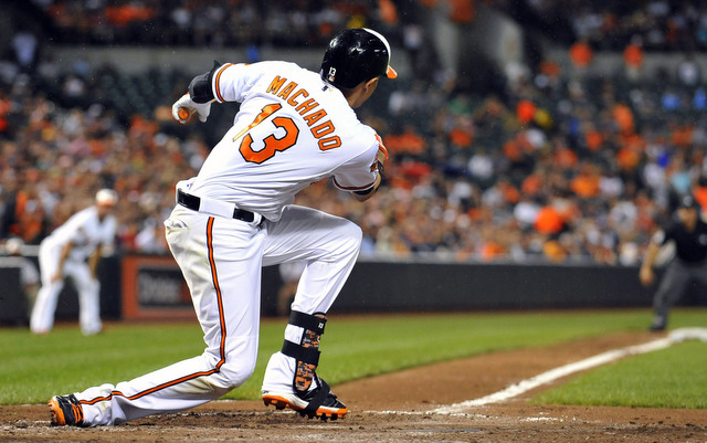 Manny Machado hurt his right knee on this swing Monday.